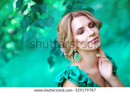Beautiful woman with green dress and elegant hairstyle