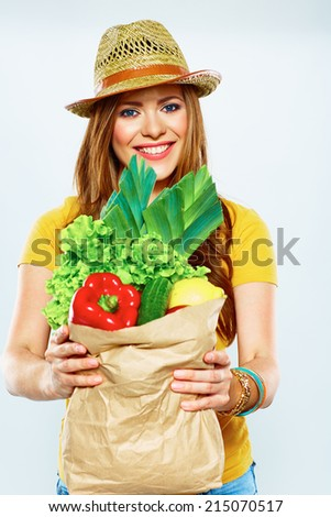 beautiful woman with green food. vegan lifestyle portrait .