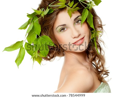 Beautiful  woman with green leaves - stock photo