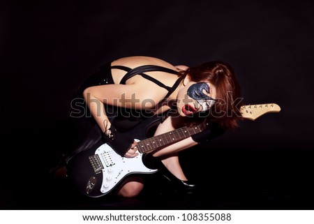 Beautiful woman with guitar - stock photo