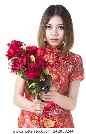 Beautiful woman with gun and flower - stock photo