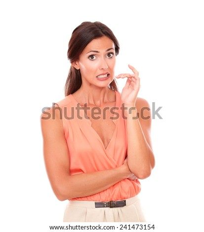 Beautiful woman with hand gesturing error while looking at you embarrassed and surprised in white background - stock photo
