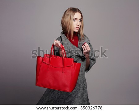 beautiful Woman with Handbag.Beauty Fashion Girl in topcoat.winter Shopping - stock photo