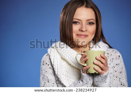 Beautiful woman with hat drinking hot tea, concept-hot winter
