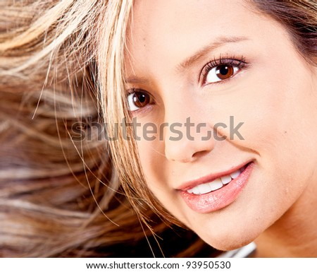 Beautiful woman with healthy blond hair smiling