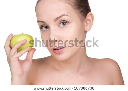 Beautiful woman with healthy clean face skin holding apple isolated on white background. Spa skin care cute girl