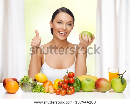 beautiful woman with healthy food showing thumbs up - stock photo