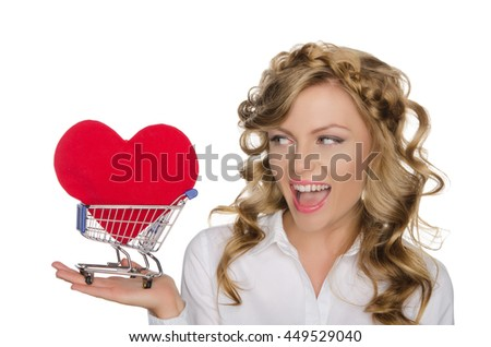 beautiful woman with heart in shopping cart isolated on white