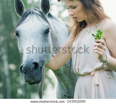 Beautiful woman with horse - stock photo