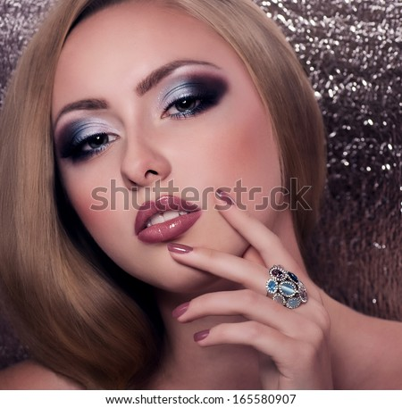 Beautiful woman with jewelry. Fashion portrait