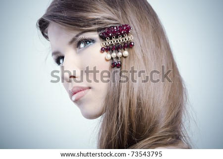 Beautiful woman with jewelry in her hair
