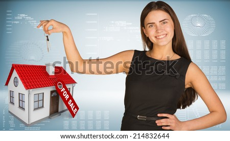 Beautiful woman with keys and small house - stock photo