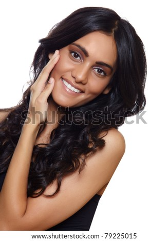 beautiful woman with long black curly hair, tanned skin and natural make-up over white background. - stock photo
