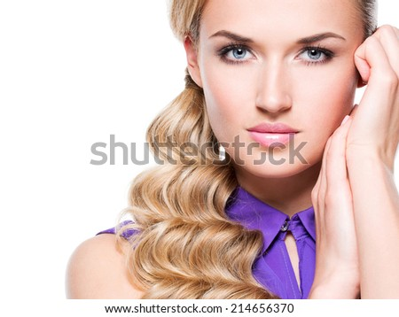Beautiful woman with long blond curly hair and hand near face - isolated on white background. - stock photo