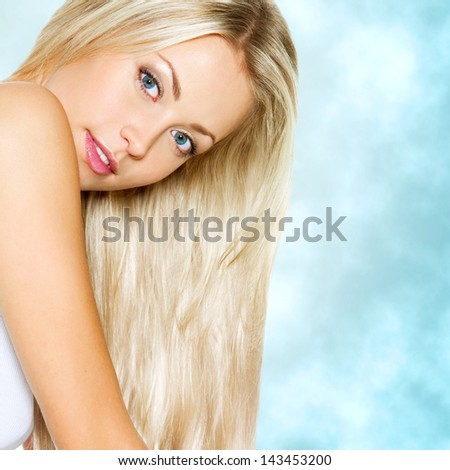 Beautiful woman with long blond straight hair - stock photo