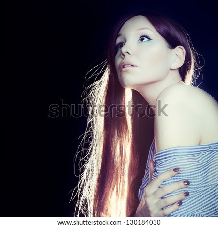 Beautiful woman with long brown hair, at night  light - stock photo
