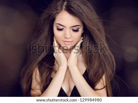 Beautiful woman with long brown hair. Fashion long hairstyles - stock photo
