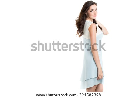 Beautiful woman with long brown hair. Portrait of a fashion model posing at studio. - stock photo