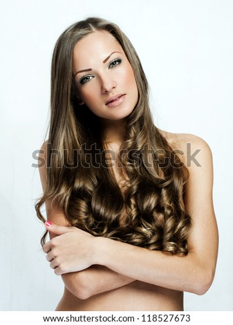 beautiful woman with long curly brown hair