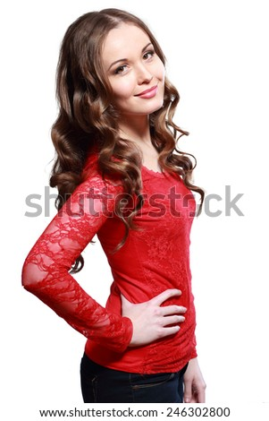 Beautiful woman with long curly brown hair. Fashion model posing at studio. - stock photo