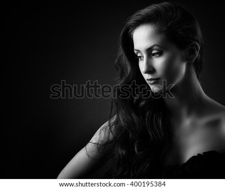Beautiful woman with long curly hair . Beautiful woman face. - stock photo