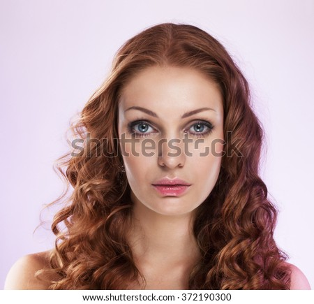 Beautiful woman with long curly hair on lilac background - stock photo