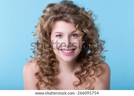 Beautiful Woman with long curly hairstyle - stock photo