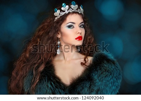 Beautiful woman with long hair in fur coat. Jewelry and Beauty. Fashion art photo - stock photo