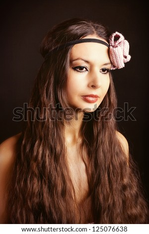 beautiful woman with long hair in studio on black