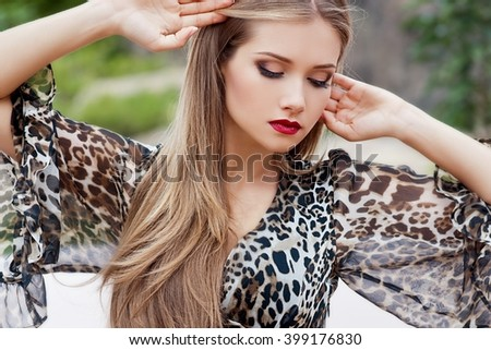 Beautiful woman with long hair outdoor. - stock photo