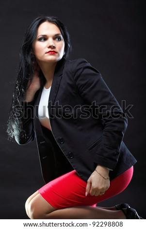 beautiful woman with long hair posing ion black background