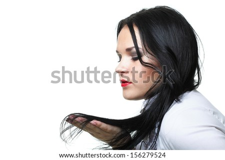 beautiful woman with long hair posing isolated on white - stock photo