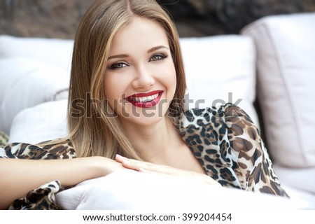 Beautiful woman with long hair. Smiling girl. Young pretty woman with beautiful long hairs and red lips - stock photo