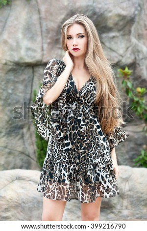Beautiful woman with long hair. Young pretty woman with beautiful long hairs and red lips  - stock photo
