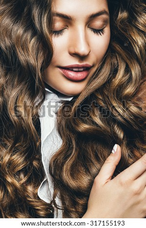 beautiful woman with long healthy hair in studio