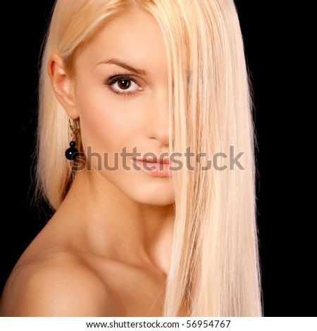 Beautiful woman with long light hair, it is isolated on black background.