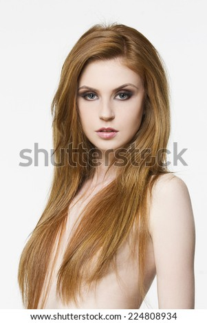 Beautiful woman with long red healthy hair and perfect skin