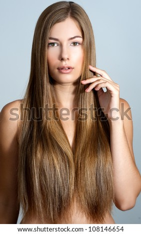 beautiful woman with long straight blond hair - stock photo