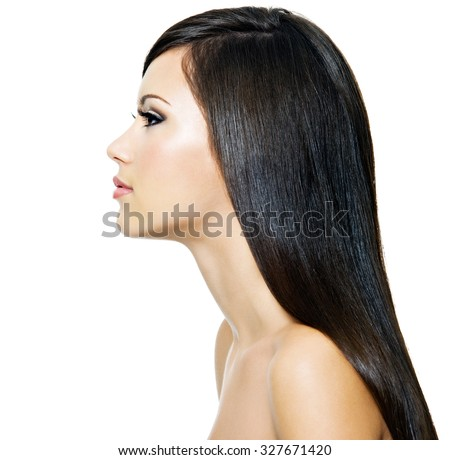 Beautiful woman with long straight brown hair,  isolated on white background. Profile portrait. - stock photo
