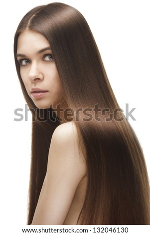 Beautiful woman with long straight hair isolated on white background