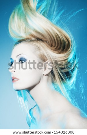 Beautiful woman with long tended hair  - stock photo