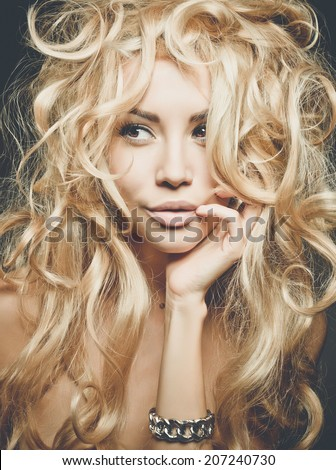 Beautiful woman with magnificent blond hair. Hair extension, permed - stock photo