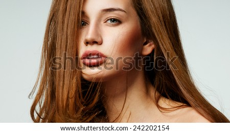 Beautiful woman with magnificent hair. - stock photo