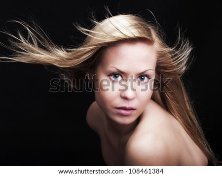 beautiful woman with magnificent hair over dark