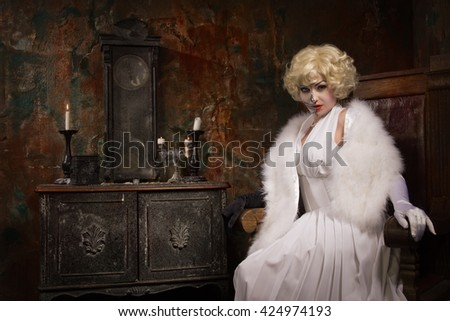 Beautiful woman with make-up skeleton in a dark gothic interior