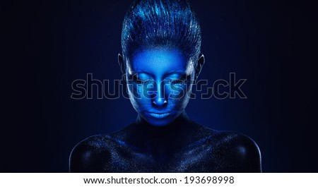 Beautiful woman with modern face art. Deep blue colour - stock photo
