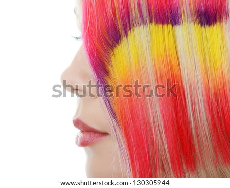 Beautiful woman with  multi-coloured strand in hair - stock photo