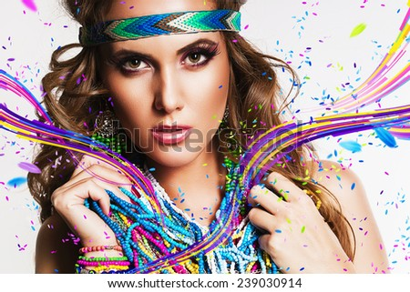 beautiful woman with multi necklace and stripes in studio - stock photo