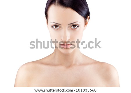 beautiful woman with naked shoulders looking at camera - stock photo