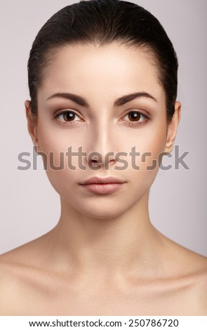 Beautiful woman with natural make-up, perfect skin - stock photo
